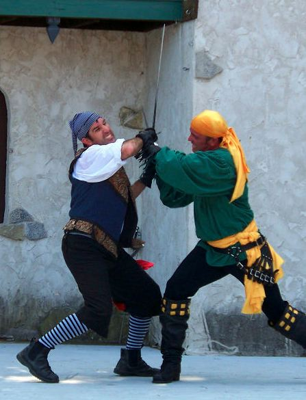 Image of two people swordfighting