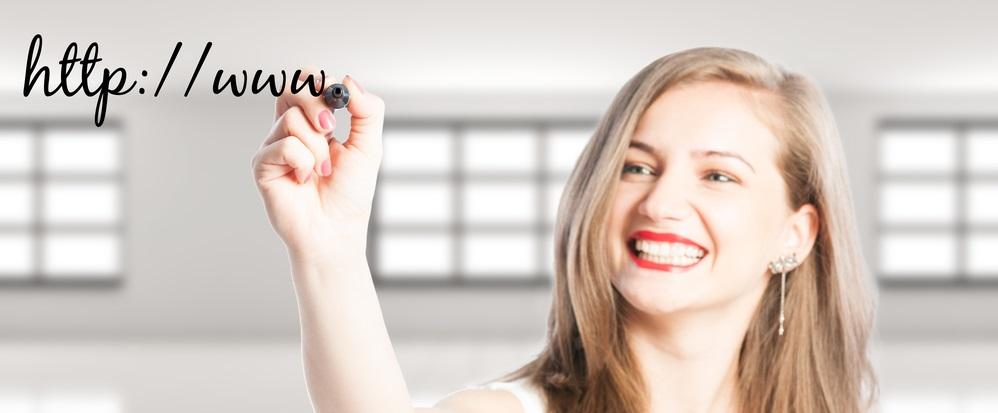 woman writing domain name for blog